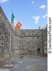 Irish Flag in Kilmainham Gaol in Dublin - Flag of Ireland in...