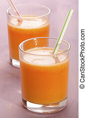 carrot and turnip smoothie in a shot glass - carrot and...