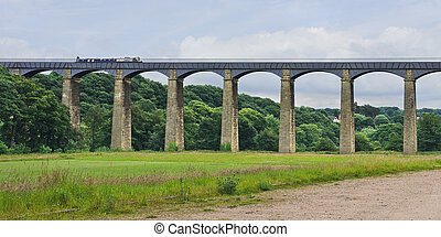 Pontcysyllte Aqueduct Wales - A narrowboat crosses the...