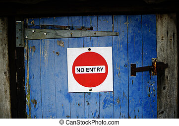 No Entry - Red 'No Entry' sign on a rustic old blue wooden...