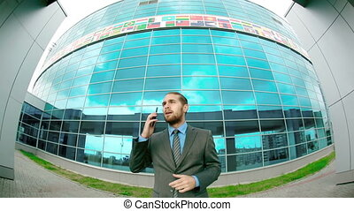 International Business - Fish eye camera shot of man...