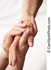 helping hands - human concept, selective focus on nearest...