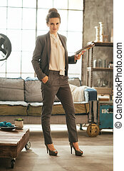 Full length portrait of business woman standing in loft...