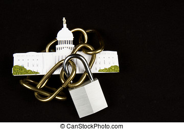 Replica of the US Capitol building encircled in chains with...