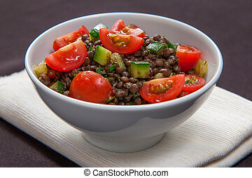 French lentil salad with tomatoes, cucumber and coriander
