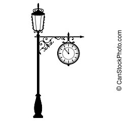 Vintage black lamppost with clock isolated on white...