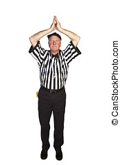 Man dressed as an NFL referee signalling a football safety...