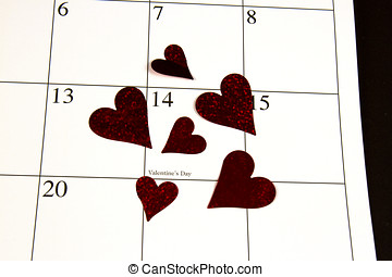 Valentine's Day circled on a calendar with red heart cutouts