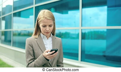 Confident Lady - Pretty girl in formal wear typing sms and...