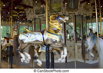 Antique wooden painted horse in musical carousel