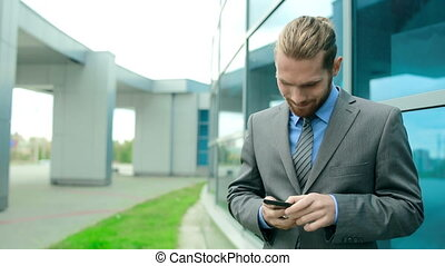 Business Call - Low angle of businessman standing at the...