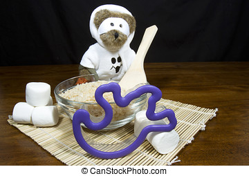 Cute halloween bear dressed as a ghost making ghost shaped...
