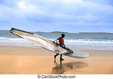 lone wild Atlantic way windsurfer getting ready to surf -...