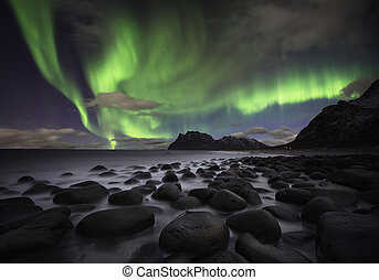Aurora beach - Beautiful aurora over the Lofoten islands,...