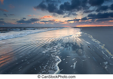 sunrise over North sea waves