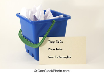 Bucket filled with wadded up paper with one sheet listing...