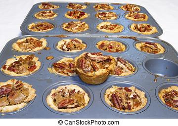 Tins of homemade pecan tarts