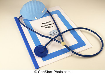 Stethoscope, surgical mask and pills atop an health...