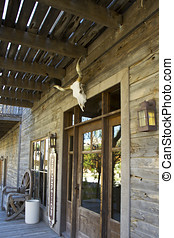 Entrance to an old wild west frontier hotel and saloon with...
