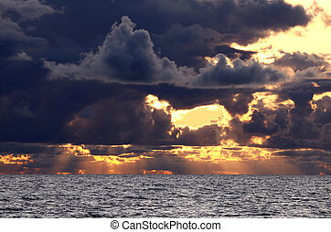 Dramatic sunset - Sunset over sea horizon with dramatic...