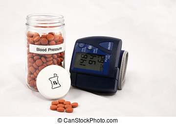 Vial of pills labelled Blood Pressure with a blood pressure...