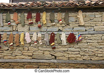 wall showcase - 18 - handmade goods on the wall of a village...