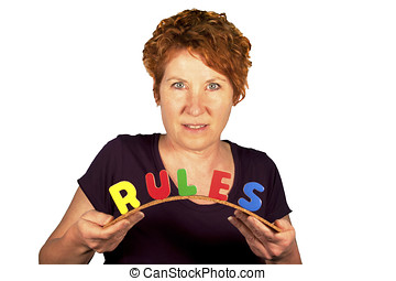 Smiling mature woman bending the word RULES