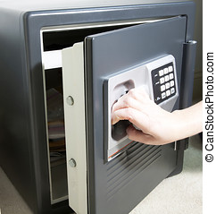 Hand opening the door of a personal safe