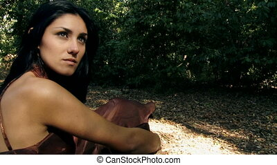 Female model posing in woods