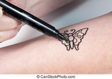 Application of a temporary butterfly tattoo