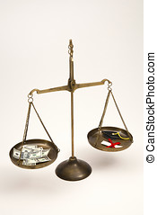 Scales balancing money vs a degree with mortar board.