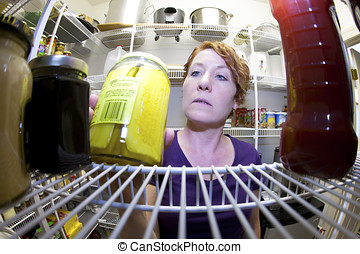 Fisheye view of a woman in a food pantry