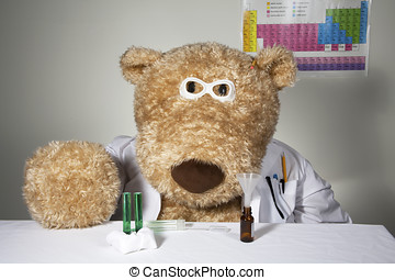 Oversized teddy bear dressed in a white lab coat with lab...