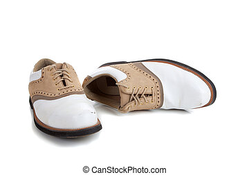 A pair of golf shoes on white