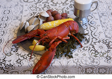 Traditional New England Clambake including lobster, clams,...