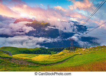 View of the foggy Val di Fassa valley with passo Sella...