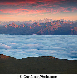 View of the foggy Val Gardena valley. National Park Odle...
