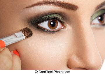 Glamour make up woman eye close up with make up brush....