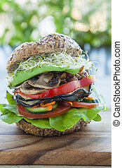 Vegan burger with alfalfa, avocado, mushrooms, capsicum,...