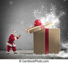 Gift of Santaclaus - Santa Claus opening a big red gift