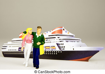 Figurine of a young happy couple in front of a cruise ship.