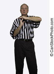Man dressed as a basketball referee giving sign for...
