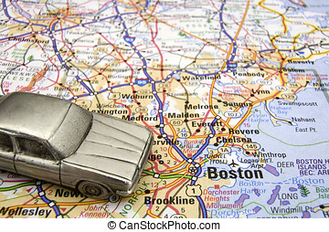 Model sedan on a road map of Boston MA
