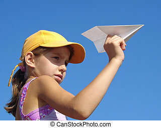 girl with paper plane - young girl with paper plane against...