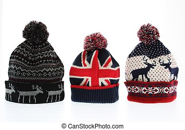 Winter woollen hats on white backgroung