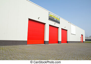 red segment doors - a business building with three red...