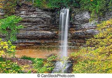 Autumn at Munising Falls - Autumn leaves surround the...