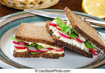 Healthy snack - wholemeal bread with egg-cream spread and...