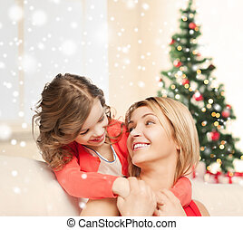 happy mother and daughter hugging at home - people,...