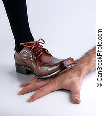 Shoe crushing a hand over white background